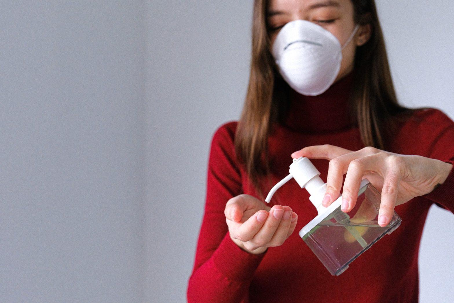 passenger-using-disinfectant